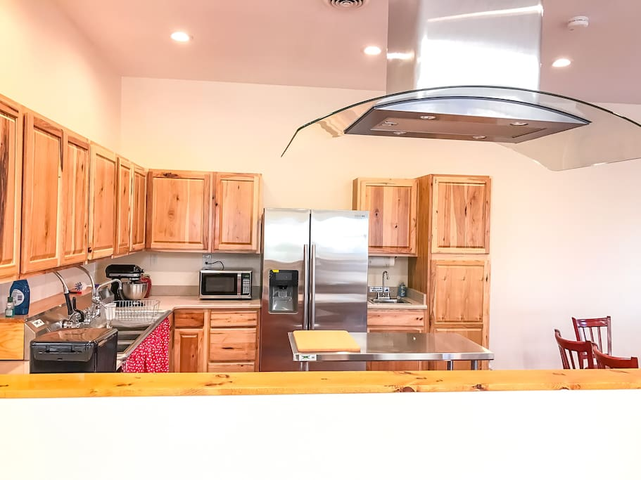 Fully equipped kitchen has everything you need to prepare a meal.  The half wall over looks sewing/common area.