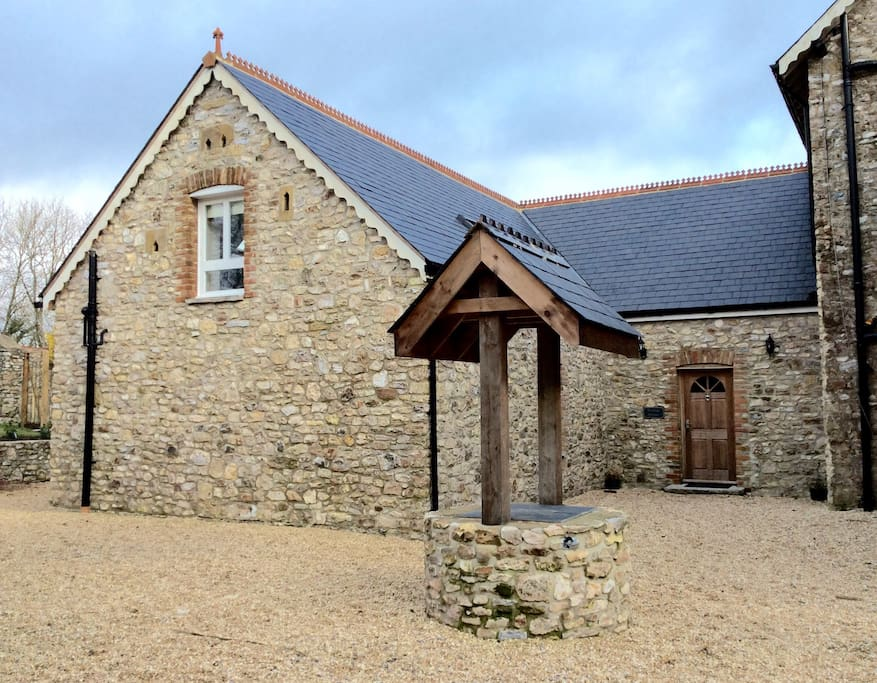 Character stone cottage with well
