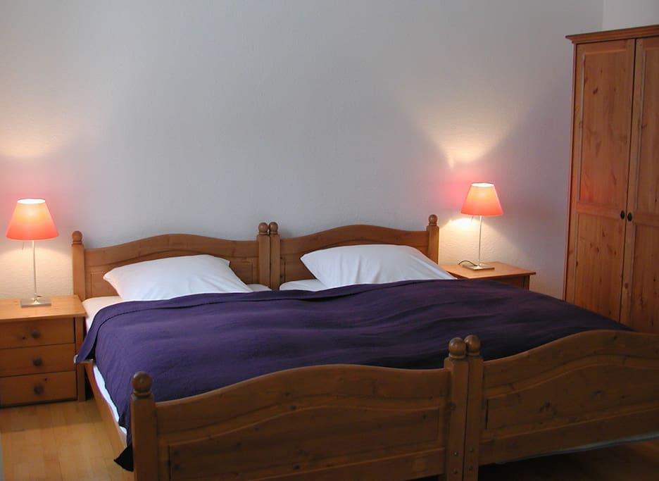 Schlafzimmer in Wohnung 2