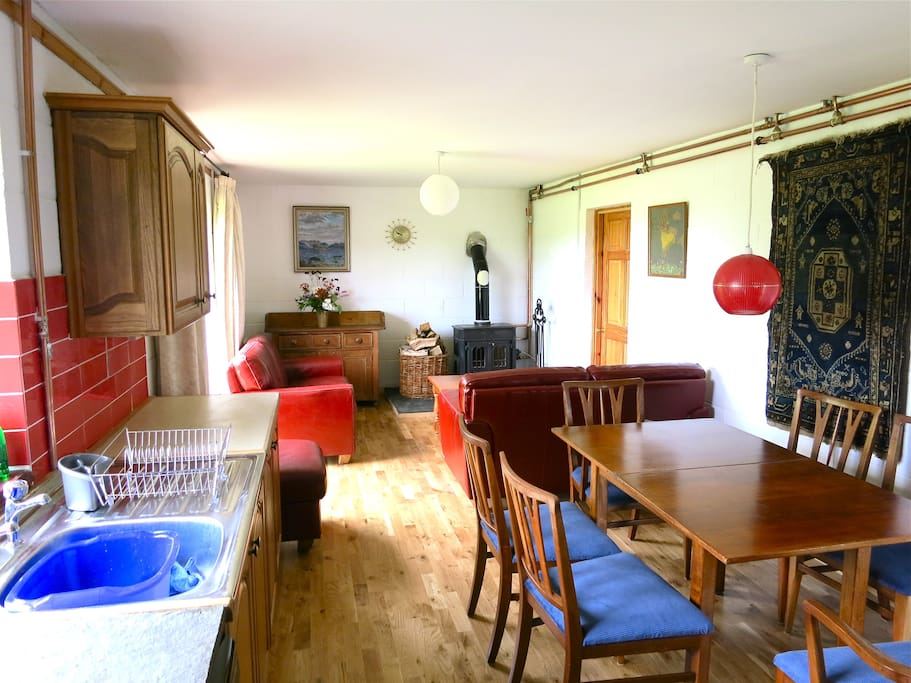 Spacious kitchen dining area with dishwasher, cooker, microwave and fridge/freezer. The lounge has a woodburning stove and comfortable leather sofas. Central heating.