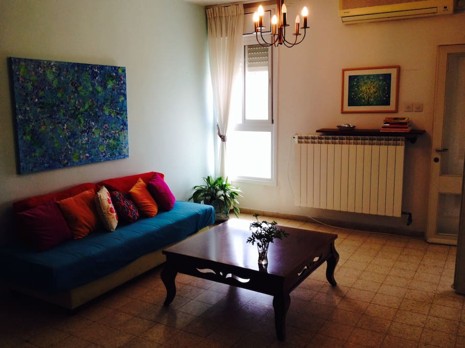 Hang out in our bright & breezy living room. Cosy in winter. Unlike most places in Israel, we have central heating