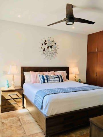 Bedroom #1 has calking bed, ceiling fan, plug in space heater