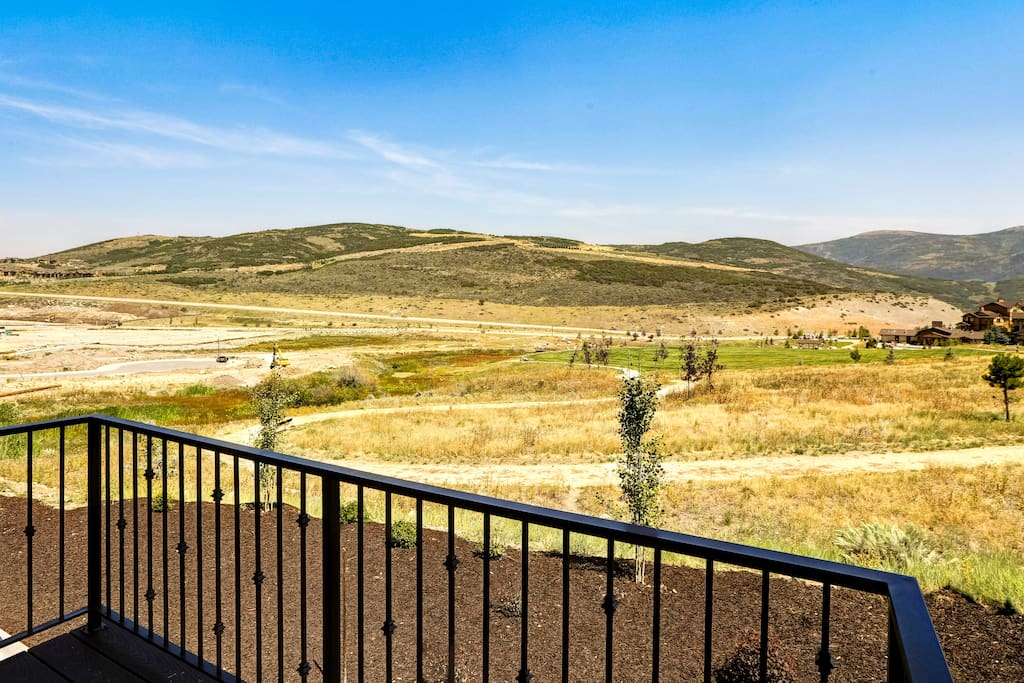 Take in a gorgeous vista of mountains and foothills from your balcony.