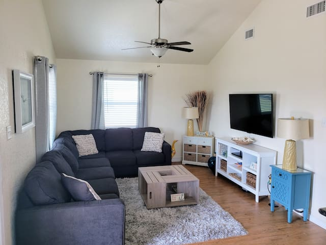 """Living Room with 55"""" Smart TV, Netflix, DVD player and Wii"""