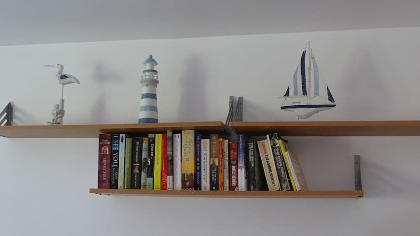 We offer a growing selection of books to borrow or add to during your stay.
