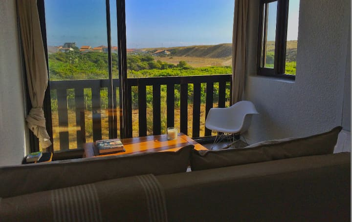 Appartement derrière la dune, l'océan à pied!
