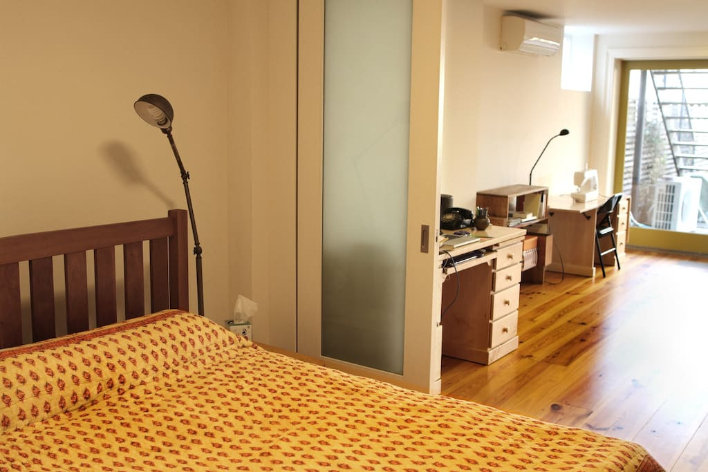 Bedroom, sliding doors open to yoga studio.