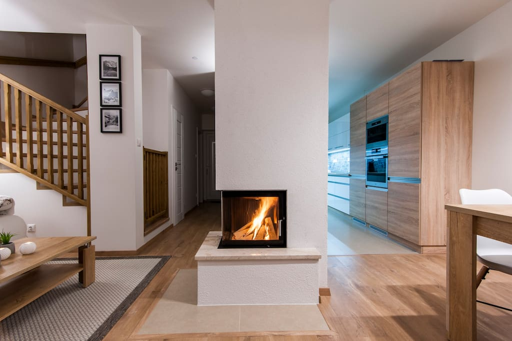 Livingroom with fireplace and kitchen (wooden brickets included)