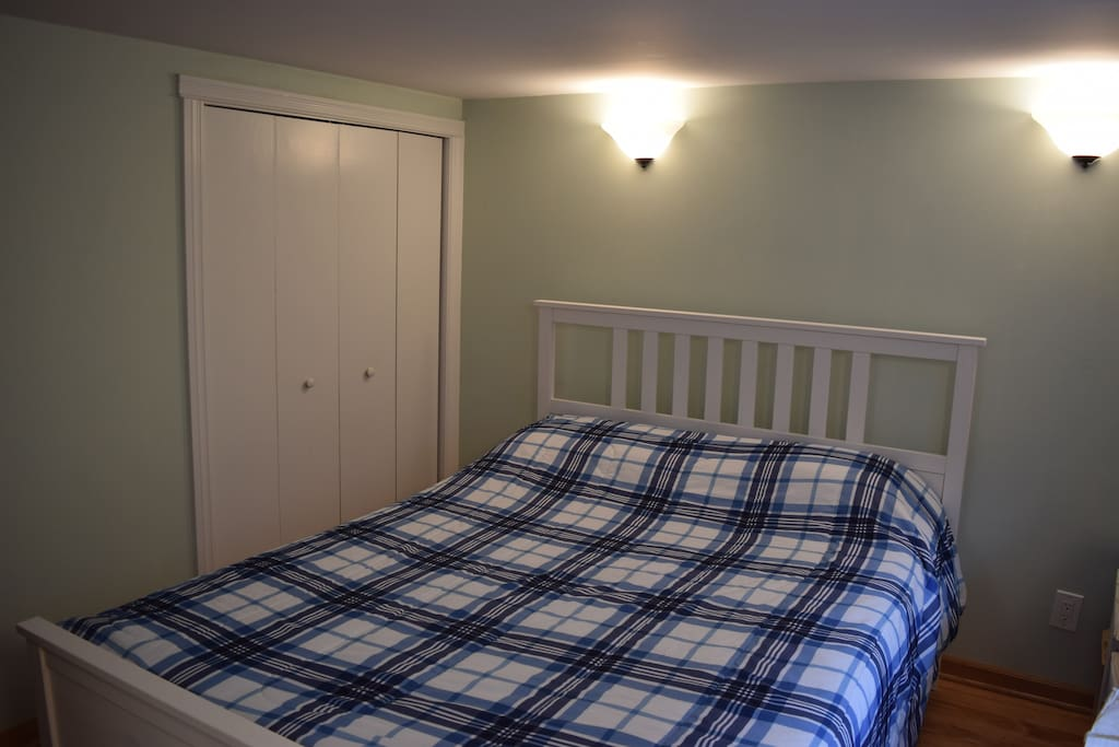 Second bedroom with queen-size bed.