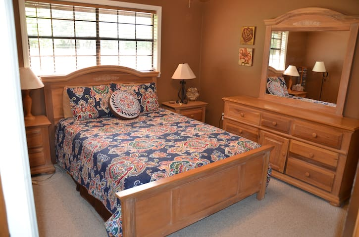 Primary bedroom with very comfortable Queen bed with dresser and plenty of hangers for clothes.