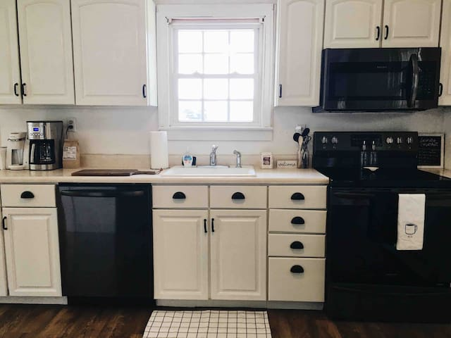 Full kitchen with brand new appliances, coffee maker, and toaster.