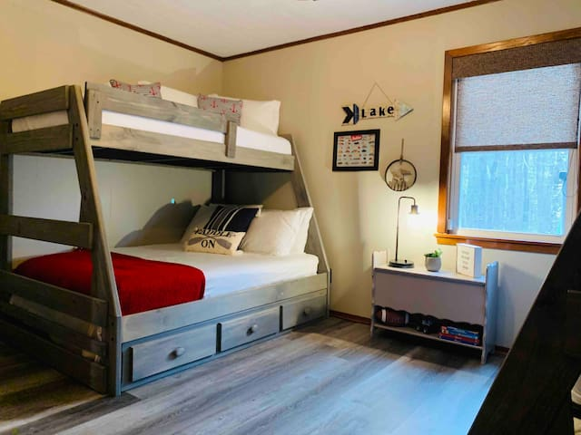 Bedroom #3 features bunk beds with 2 twin beds over two full beds on bottom. Children's toys, books, movies are stored in drawers under bottom beds. Some are left free for storage of personal items.