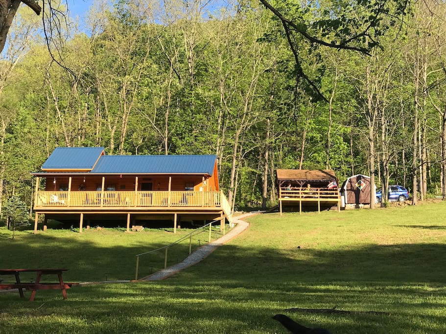 The cabin sits on 1.8 acres with 90 yards of water frontage.  Up behind the cabin is a covered shelter house with dining area and gas grill with an open deck in front.