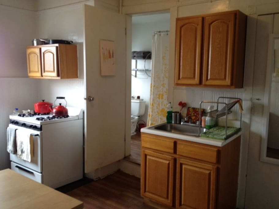kitchen with oven, tea kettle, coffee maker, and toaster oven.