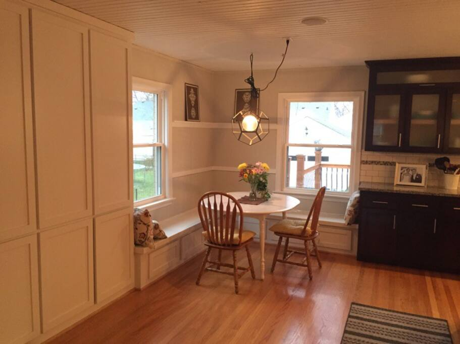 Brightly lit dining area off kitchen.