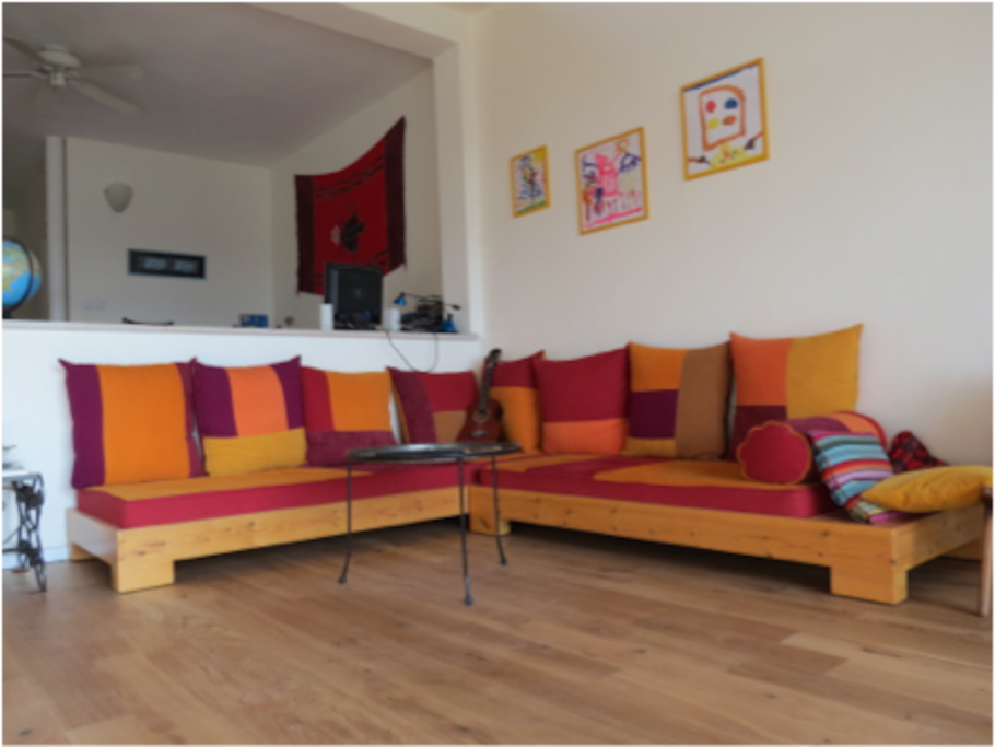 Very large wooden-floor lounge and living area with a special atmosphere and incredible views to the hills