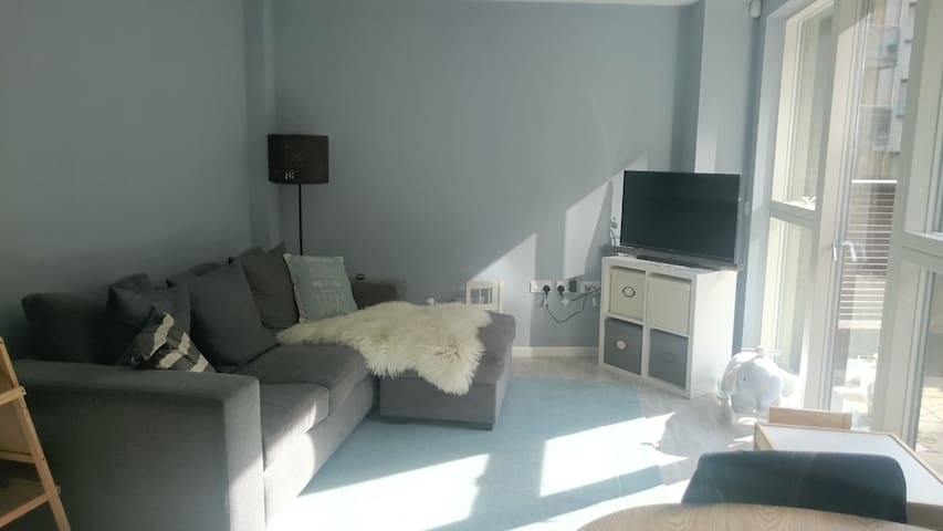 Spacious Dining and living room area. With TV. Comfortable big sofa