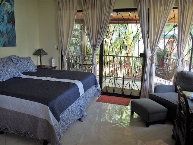 Aviary room  with king bed with balcony and communicating  bridge to the Rancho