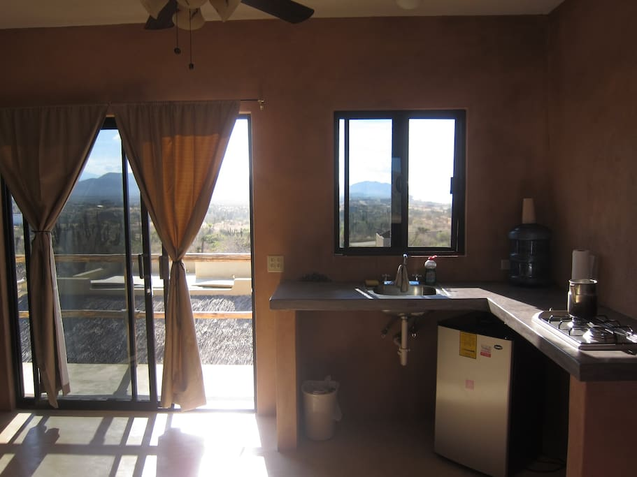 The kitchenette and the entrance to the balcony.