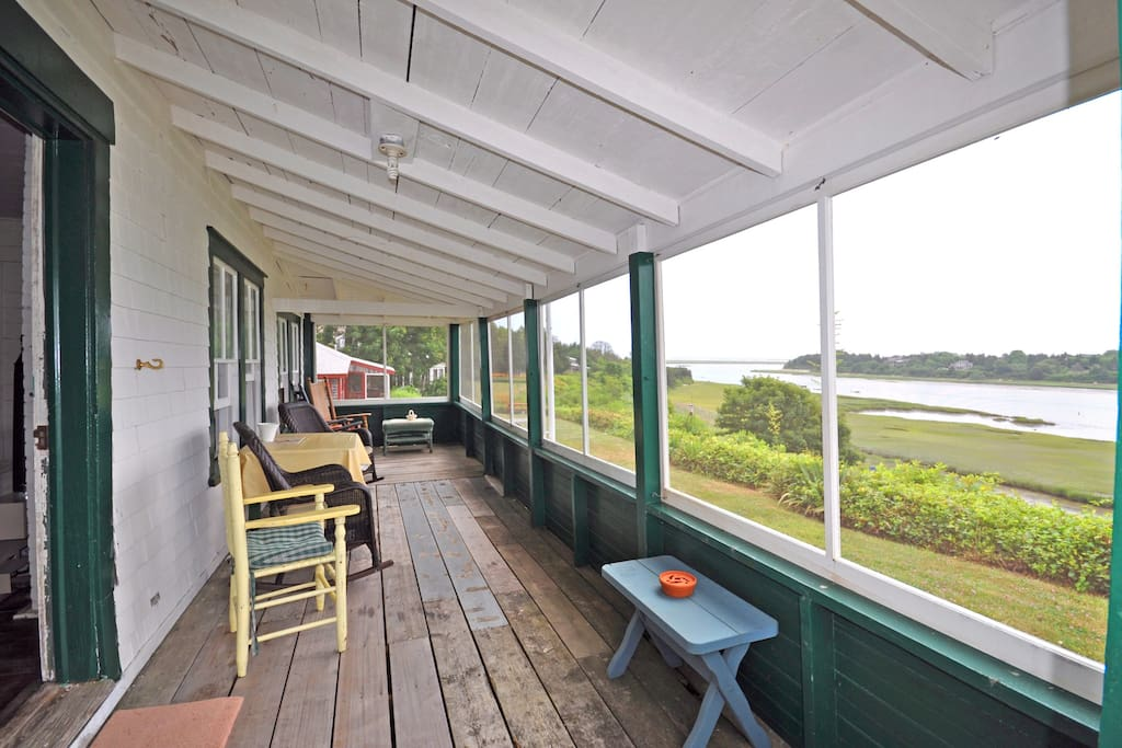 McKechnie Cottage Porch with views of town  cove and ocean beyond