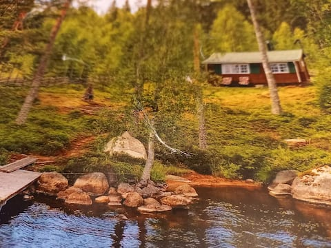 Cozy little cottage with lake plot, boat and jetty!
