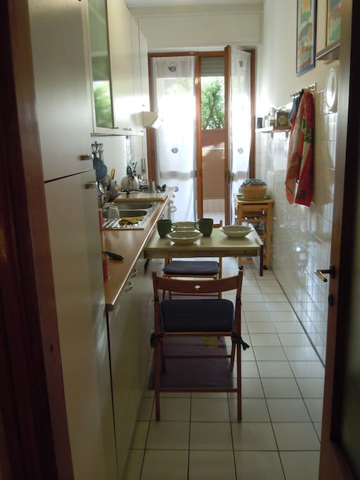 fully equipped kitchen with dish-washer, gas kitchen with security system, electric oven, small pull-out table for breakfast. Exit to terrace
