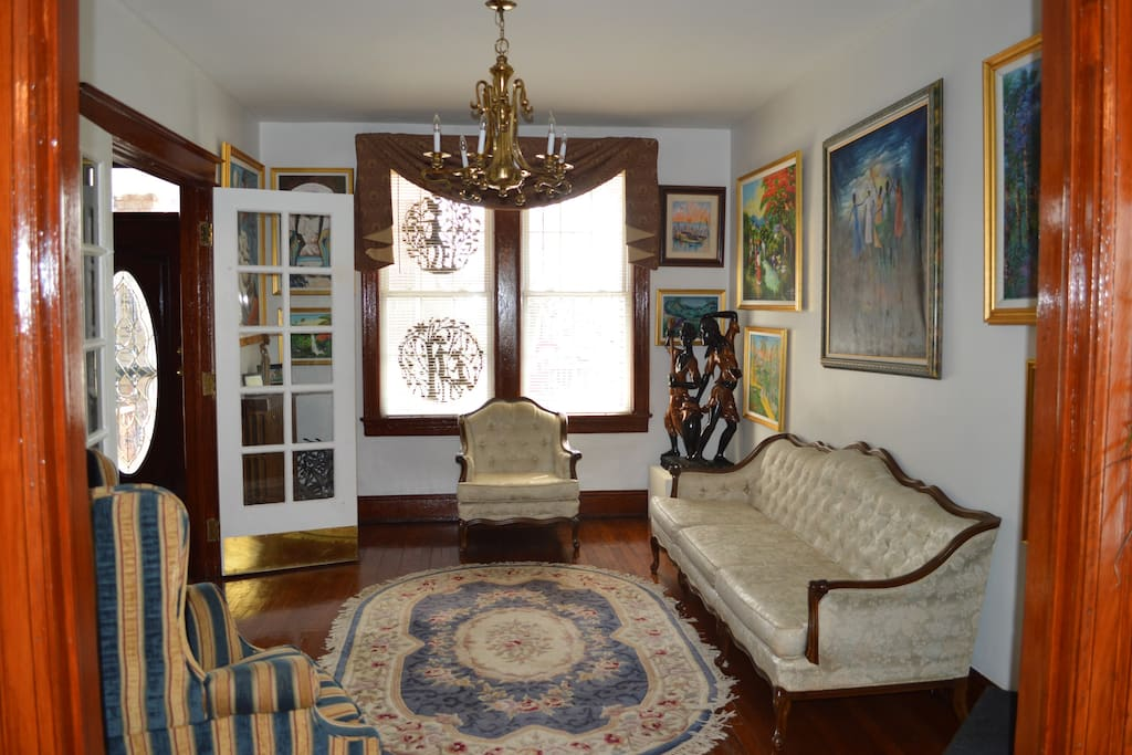 This is the formal living space with multiple seating areas and beautiful artwork surrounding the room. Please feel free to admire the beautiful sites of Haiti through the vibrant and decorative art!