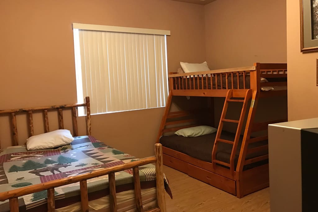 Queen bed, bunk bed twin over a full. Closet, TV, and DVD.