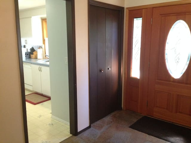The front door and entryway with a view into the kitchen.