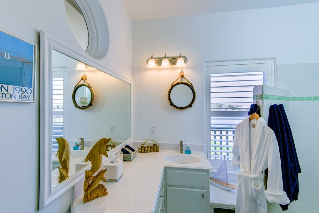 Bathroom with walk-in shower & plush robes for lounging