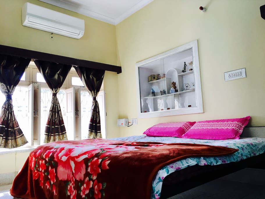 Chip: A relaxing cream color painted room comes with AC newly fitted AC not notch O'General Air conditioner. This room sports a huge entire wall set window with a beautiful garden view. The room also has mat white colored royal wooden word.