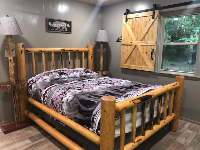 This bedroom has a queen bed.  The closet space is open with a bench to sit on and/or place your luggage.  Hangers are provided for guests during their stay.