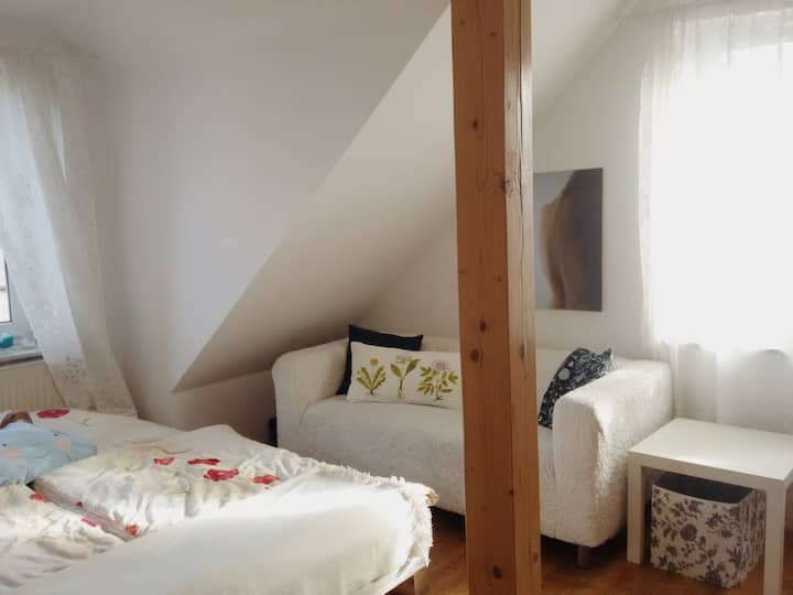 Double bed room in two-level, bright apartment
