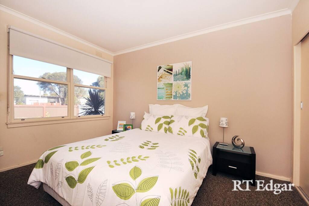 Comfortable queen size bedroom