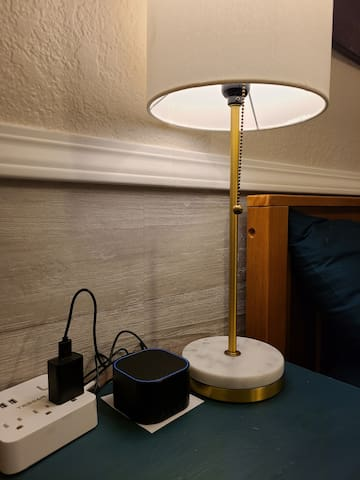 Power plug with USB ports, lamp and sound machine for restful sleeps
