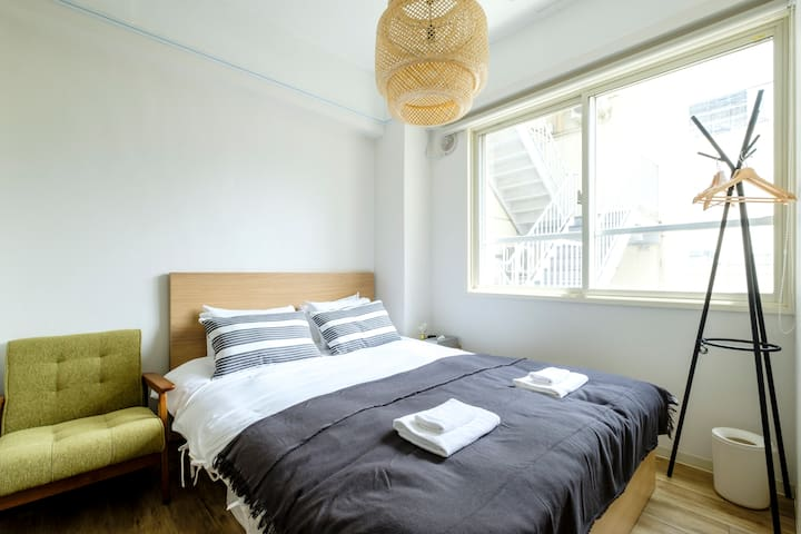 There are 2 comfortable double beds inside the bedroom.