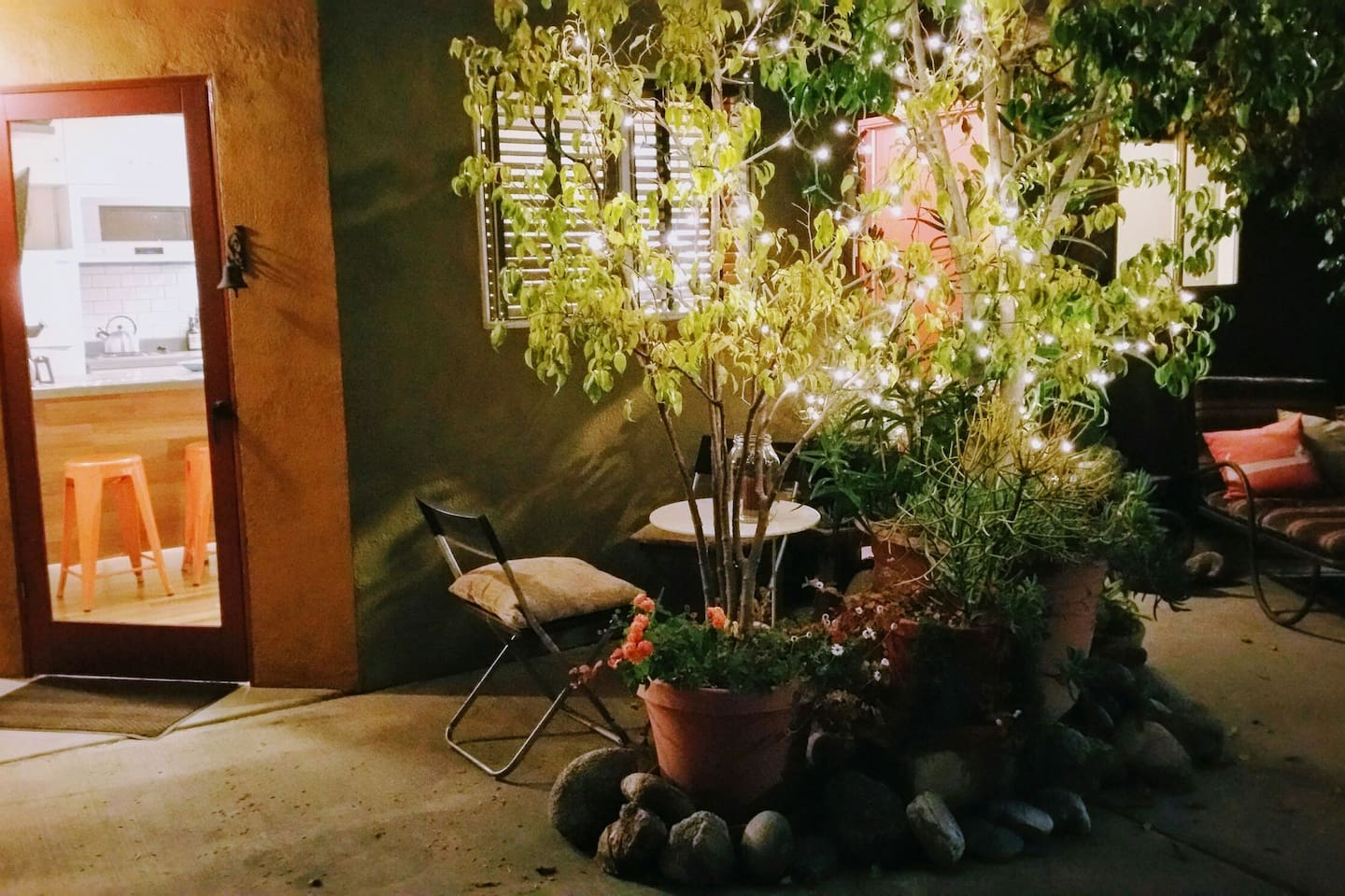 Your door and bistro table under the twinkle lights.