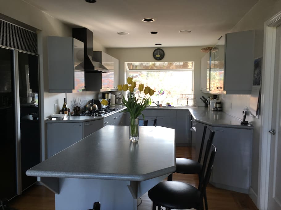 Kitchen with island and barstools