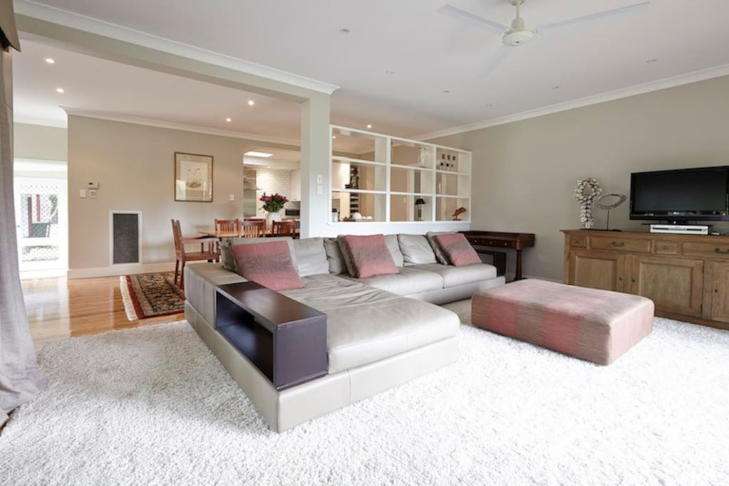 Large lounge room with comfy leather lounge and wood fire...