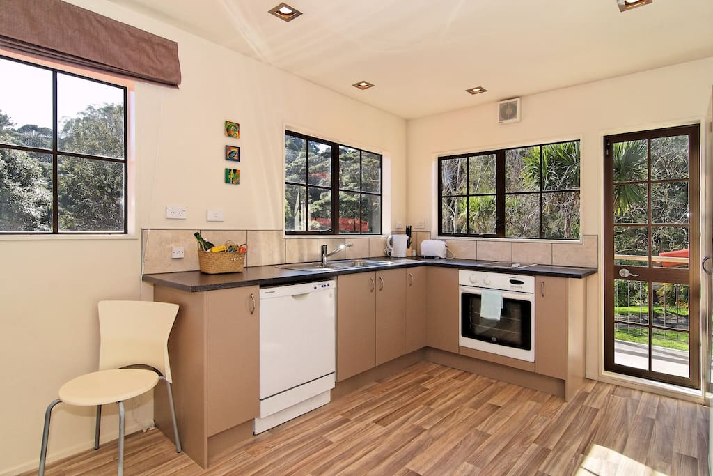 kitchen with views over Swanson Reserve