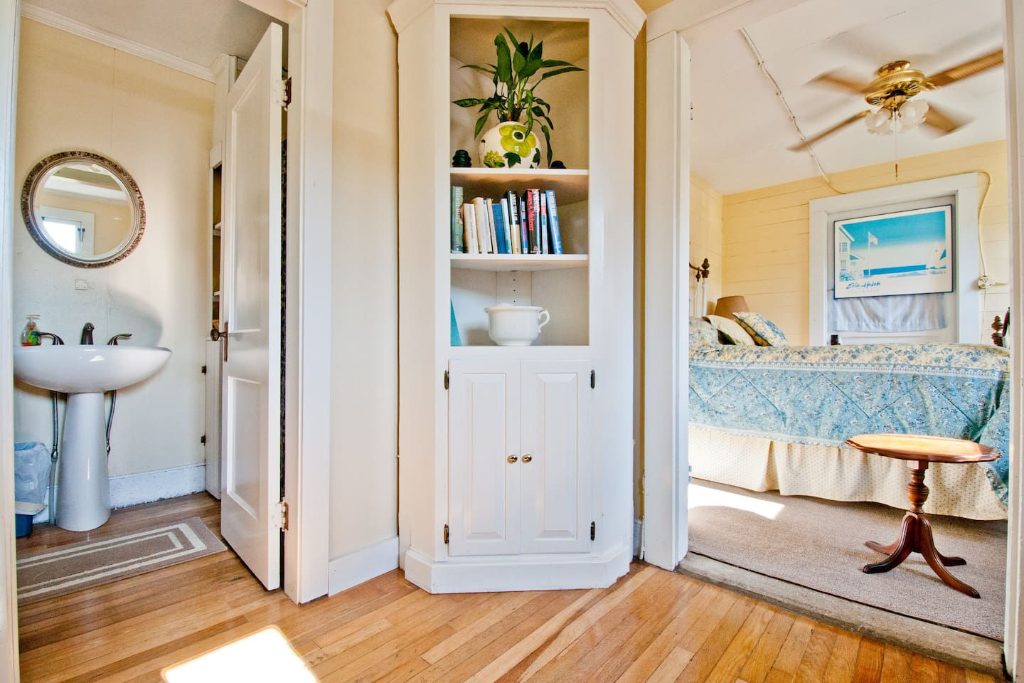 This guest suite is made up of three rooms - a small siting room, a small bedroom, and a full bathroom.