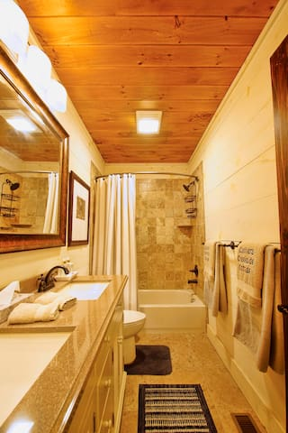 Lots of space in the bathroom with a tub and/or shower and double sinks.