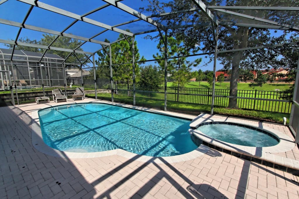 Make the time to enjoy some of the Florida lifestyle when you stay at this wonderful vacation home. Sit and enjoy an outdoor meal under the shade of the lanai as you look out to the pool and beyond, to the landscaped parkland behind this home.