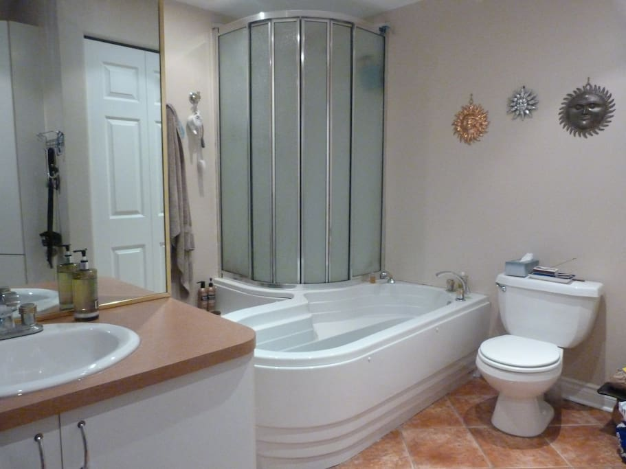 Large renovated bathroom with washer/dryer.