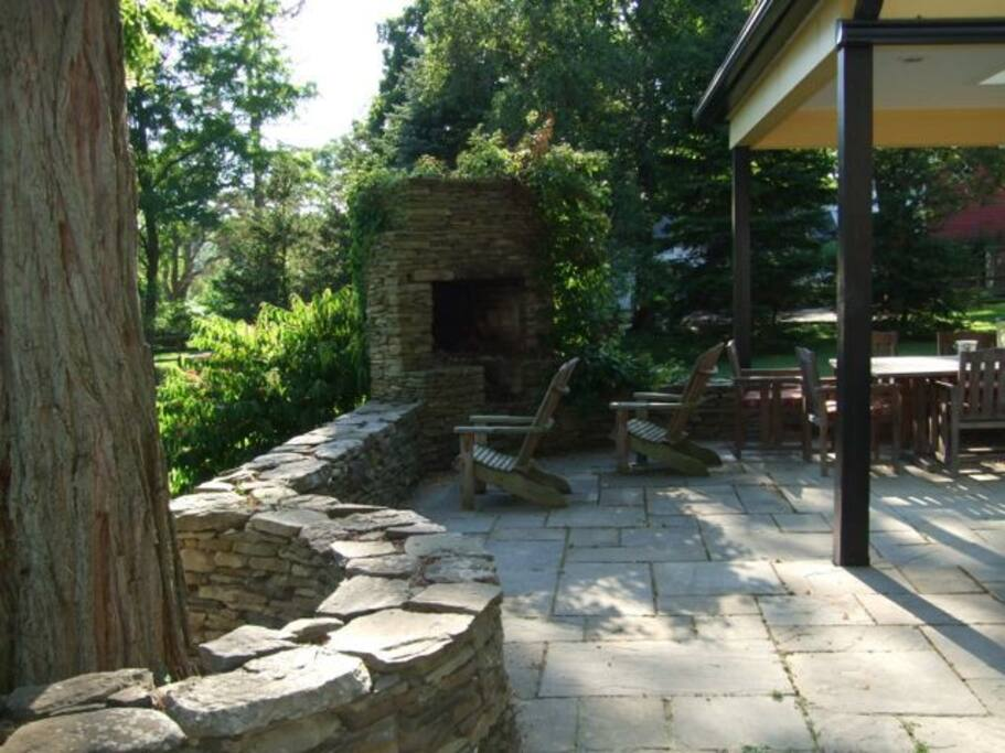 Outdoor fireplace on stone patio