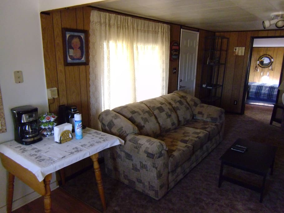 Living room equipped with tv and dvd player,movies also available.