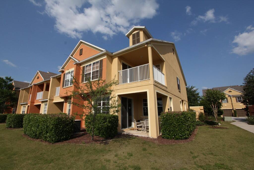 This spacious 4 bedroom town home is an end-row unit, so it has extra space and a private balcony and lanai where guests can relax and watch the world go by while enjoying their vacation.