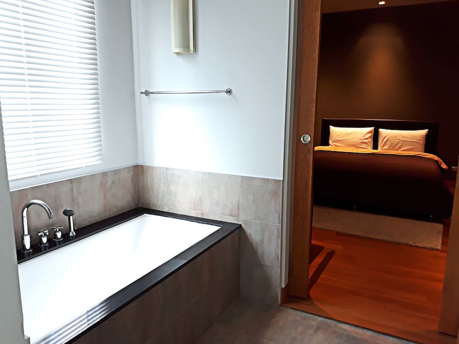 Master bedroom is connected to the main bathroom with bath tub
