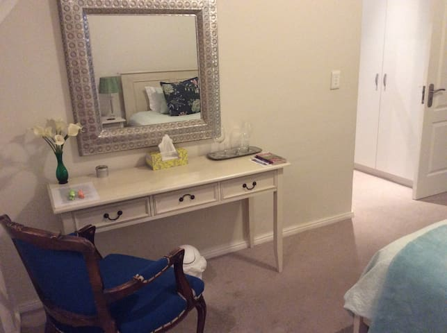 Dressing table or desk.  Hair dryer included.