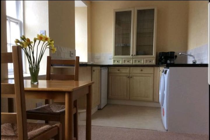 The compact kitchen has a fridge. Washing machine.2 ring hot plate. Combi microwave.